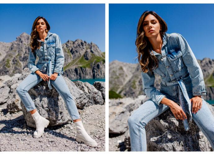 Jeansowy kombinezon damski z długim rękawem, kieszeniami i wiązaniem w talii